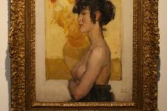 Museum-Jan-Cunen-143-Isaac-Israels-1918-Vrouw-in-profiel-voor-Zonnebloemen-van-Van-Gogh