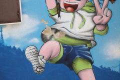 Sint-Truiden-322-Muurschildering-op-speelplaats-bij-school