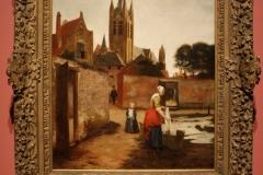 Pieter-de-Hooch-1658-ca-Vrouw-en-kind-bij-het-bleken-van-laken-1
